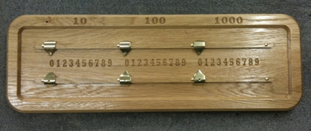 solid oak score board with carved numerals