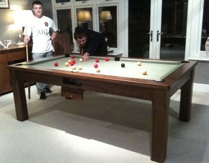 Solid Walnut pool dining table playing as a pool table
