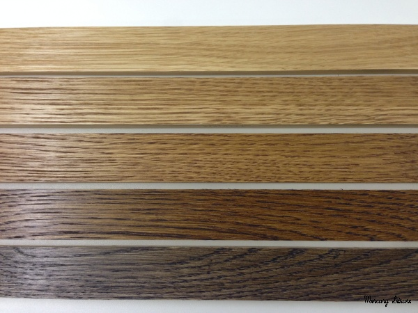 Wood stain sample colurs on oak pool table wood
